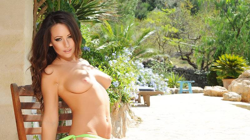 Anastasia stripping from her bikini in the garden