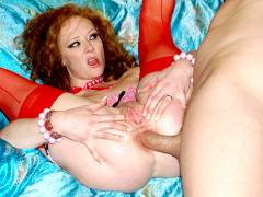 Audrey slides a big toy along the cock in her ass