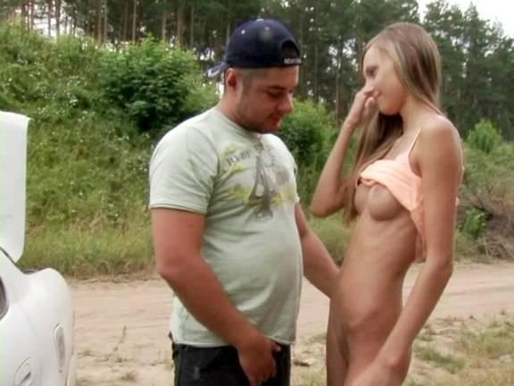 Tanned blonde girl strips before strange guy in the street